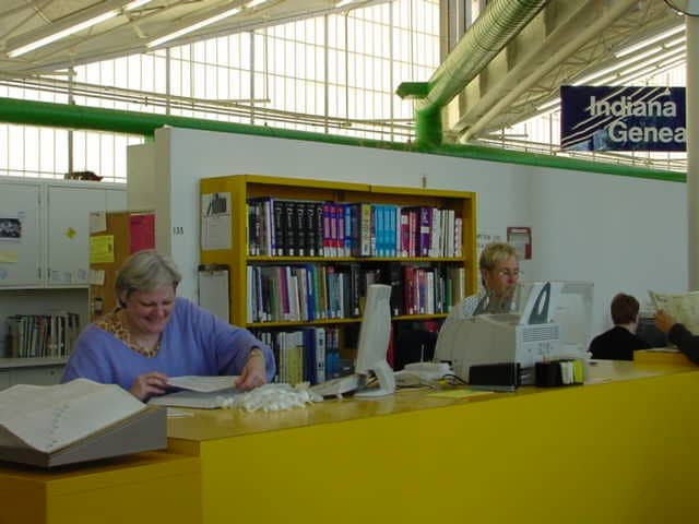 two people at reference desk
