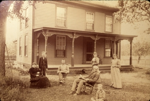 Lloyd family in front of home