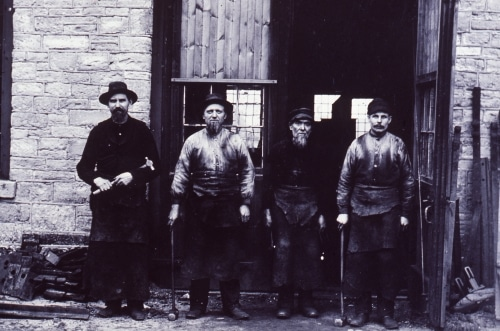 four men in front of Michigan Central Railroad Repair Shops