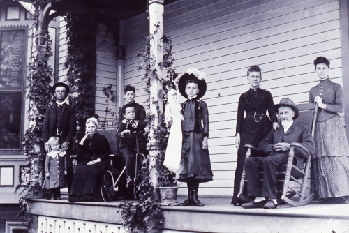 Family photo on porch, early 1900s