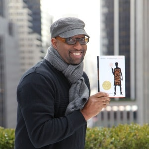 Kwame Alexander Holding Book
