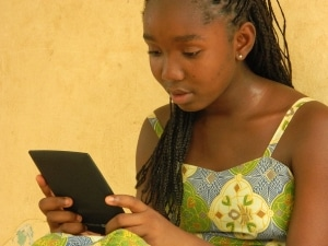 girl holding tablet or ereader