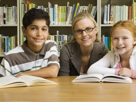 woman with two children reading books