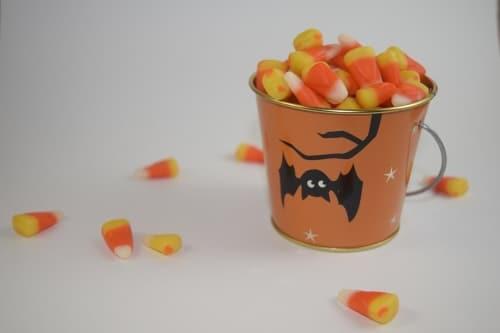 candy corn in Halloween bucket