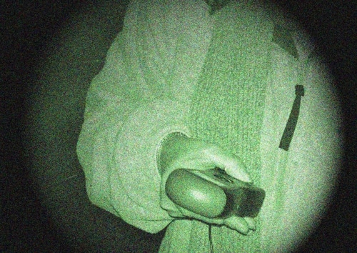 holding sensing equipment in night-vision shot