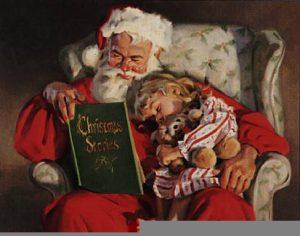 Santa reading a book to little girl