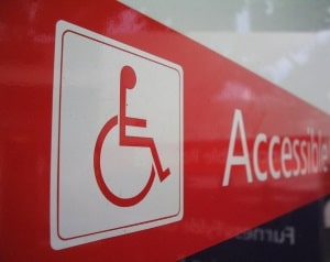 sign with wheelchair icon and 'accessible'