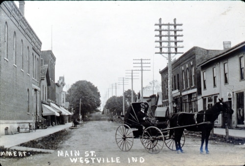 horse and carriage on Main Street of Westville