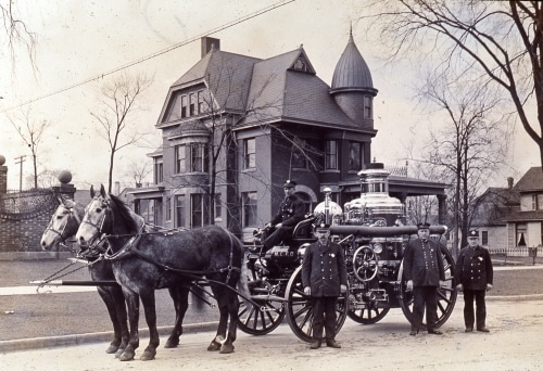 Horse-drawn pumper in front of Carlisle house