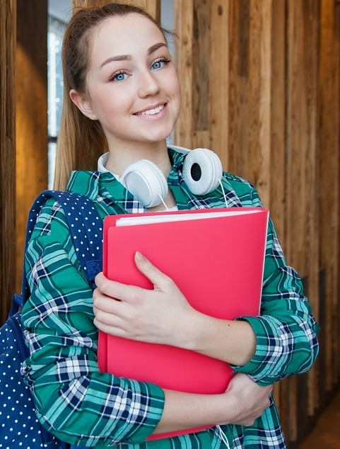 teen girl holding folders
