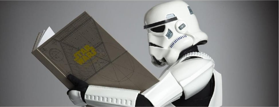 Star Wars stormtrooper holding a book